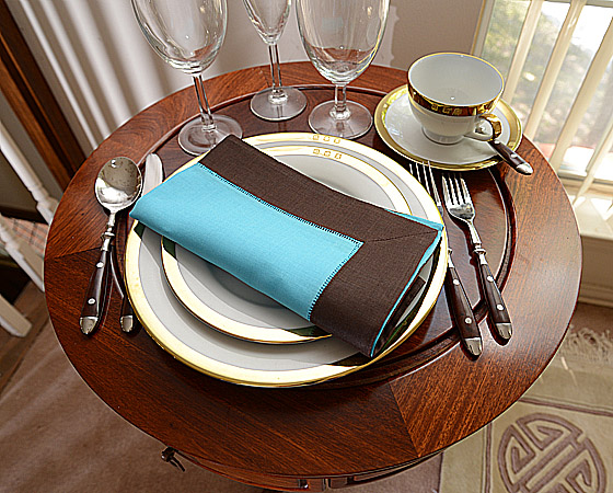 festive dinner napkin. Aqua and Brown color