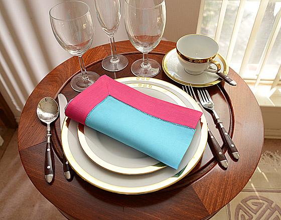 festive dinner napkins. aqua with bright pink color