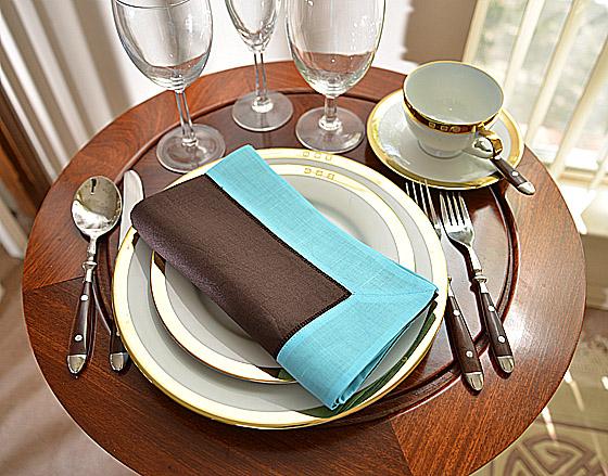 festive dinner napkin. brown with aqua color