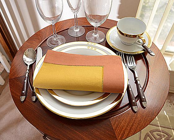 festive Burnt orange dinner napkin. honey gold color