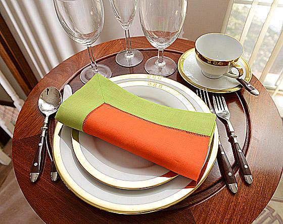 festive dinner napkin. hot orange and hot green color