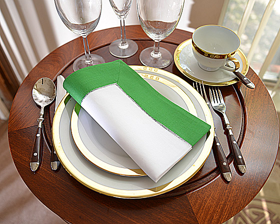 Hemstitch Festive Dinner napkin. White and Christmas Green