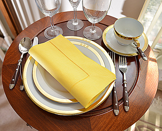hemstitch festive dinner napkin. warm yellow color