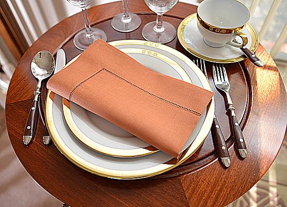 hemstitch festive dinner napkin. Burnt Orange color