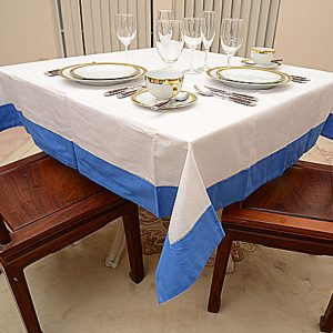 French Blue colored trimmed tablecloth. 54″square