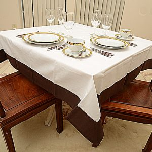 Chocolate colored trimmed 54″square tablecloth.