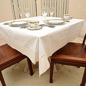 Winter White colored trimmed 54″square tablecloth.