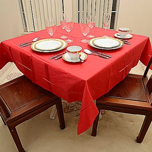 Red color tablecloth. 54″square.