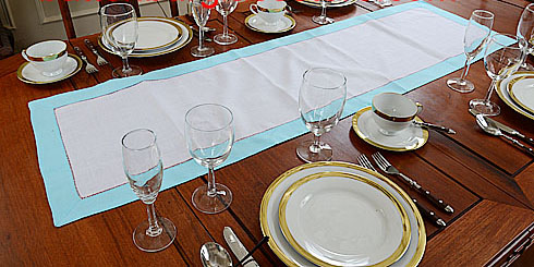 Festive table runner. 16x54. white with turquoise color trims
