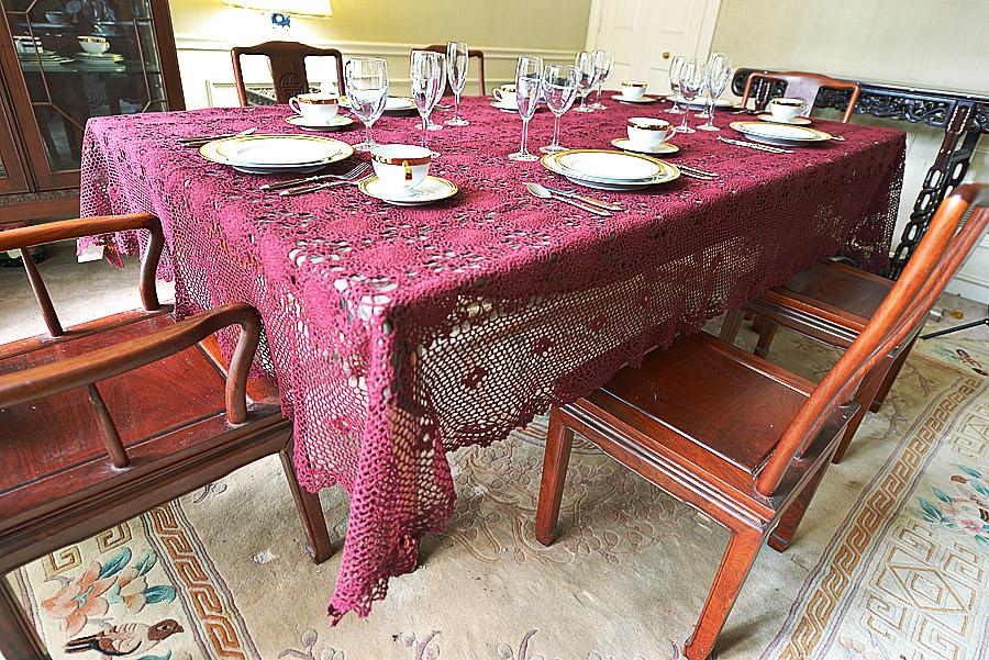festive maroon crochet tablecloth