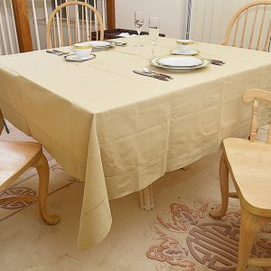 Taupe 70″square tablecloth.